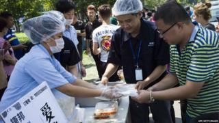 Rescue workers hand out meals