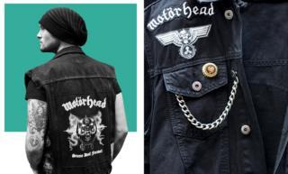 Sam wears a Motorhead jacket.