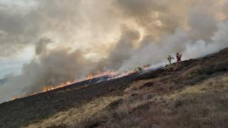 Firefighters on the moorland