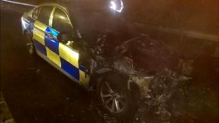 Burnt-out police car