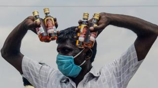 India liquor consumer after shops opened