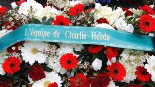 A wreath of flowers outside Charlie Hebdo's former offices in Paris on the fifth anniversary of the attack on the satirical magazine that killed 12 people, 7 January 2020