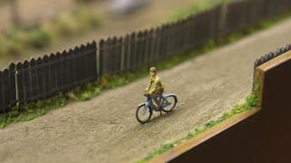 Man on bicycle in Alloa layout