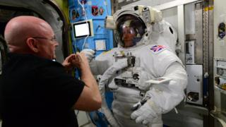 Scott Kelly check's Tim Peake's spacewalk suit