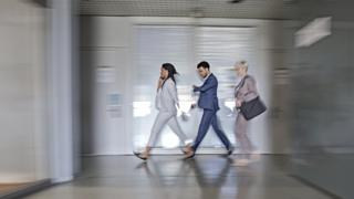 Workers walking in an office