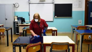 Technology Cleaner in empty classroom in Turin, 2 Mar 20