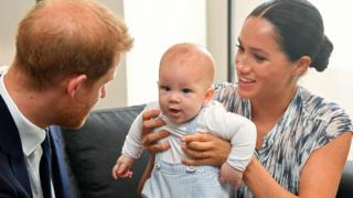 Prince Harry and his wife Meghan pictured with their baby son, Archie