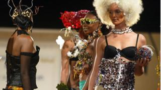 Models present creations by French designer Catherine Bizoux at the International Festival of African Fashion (FIMA), 01 December 2005, in Niamey.