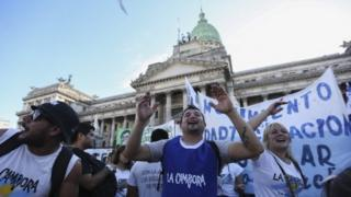 A group of people protest in front of the National Congress of Argentina in Buenos Aires, Argentina, 15 March 2016.