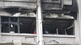 Fire inspectors view damages after a fire broke out at the Taipei Hospital in Hsinchuang, New Taipei City, Taiwan, 13 August 2018