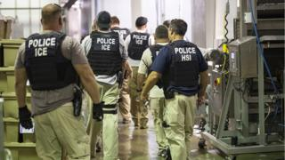 An ICE handout photo showing US immigration officers in a plant in Mississippi