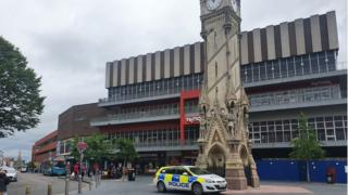 Police next to the city's clock tower