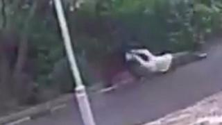 Woman dragged along ground by robber