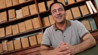 Riace mayor, Domenico Lucano poses in his office in 2011