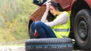 Woman tired with car tires