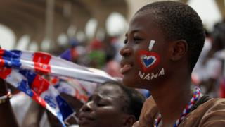 "On Saturday, 7 Jan, a youngster ""wears"" on the cheek his support for Ghanaian new President Nana Akufo-Addo during his inauguration in Accra."