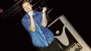 A picture of Graham Norton performing at the Leicester Comedy Festival in 1997