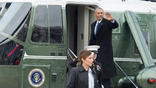 Barack Obama waves as he boards a Marine helicopter at the US Capitol.