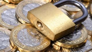 Padlock on coins
