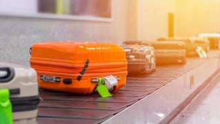 Suitcase or luggage with conveyor belt in the airport - Stock image