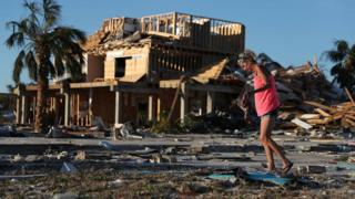 Roxy Atchley looks for items to salvage from where her friend's home once stood before it was knocked down when Hurricane Michael passed through the area on October 11, 2018 in Mexico Beach, Florida.