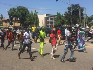Shiite protest for Abuja: Gunshots, teargas fire dey scata Wuse 2
