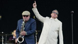 Carl Smyth, left, and Graham McPherson -better known as Suggs from British band Madness - perform at the 2016 Glastonbury music festival