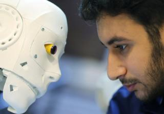 Egyptian mechanical engineer Mahmoud El komy is seen beside the remote-controlled robot that he build to test people for the coronavirus by running PCR tests, limiting exposure to suspected cases, during the global outbreak of the coronavirus disease (COVID-19), in Cairo, Egypt June 12, 2020.