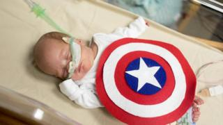 Baby in a Captain America costume
