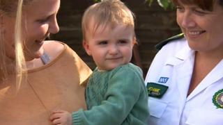 baby with mum and paramedic