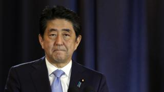 Japanese Prime Minister Shinzo Abe talks during a press conference in Buenos Aires, Argentina, Monday, Nov. 21, 2016.