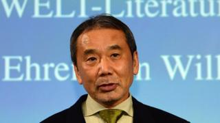 Japanese writer Haruki Murakami poses for photographers prior to an award ceremony for the Germany's Welt Literature Prize bestowed by the German daily Die Welt, in Berlin on 7 November 2014.