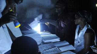 Election officials count votes at a polling station in Conakry on October 11, 2015, during the first round of the country's presidential election in Conakry on October 11, 2015.