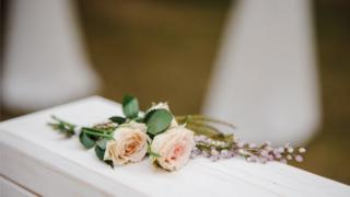 roses on a coffin
