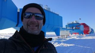 Peter Gibbs in foreground in front of Halley. Made up of several blue pods.