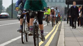 People cycle to work in the morning on Waterloo Bridge, London.