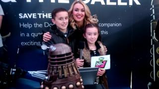 Hayley with some coders who were learning how to guide Daleks through a maze