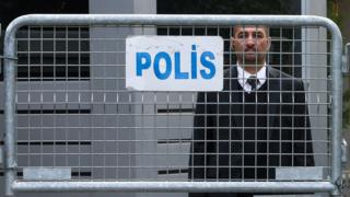 An official stands behind police barriers at the Saudi consulate in Istanbul, Turkey, 21 October 2018