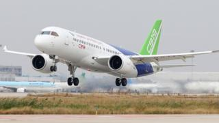 Comac C919, China's first large passenger jet, takes off from Pudong International Airport in Shanghai on 10 November 2017