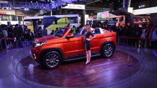 Car and model at annual India motor show