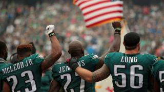 Rodney McLeod #23, Malcolm Jenkins #27 of the Philadelphia Eagles raise their fists in protest during the playing of the National Anthem as teammate Chris Long #56 shows support before a game against the Arizona Cardinals.