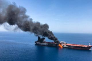 The Norwegian-owned crude oil tanker Front Altair is seen on fire in the Gulf of Oman