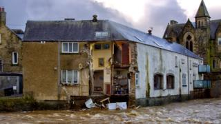 in_pictures Part of the Bridge House Guest House and Sonia's Bistro in Hawick, Scotland, collapsed into the fast-flowing River Teviot as Storm Ciara battered the UK with high winds and heavy rain, 9 February 2020