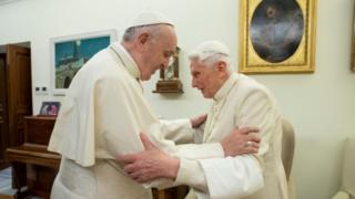 Pope Francis and Pope Benedict embracing in the Vatican