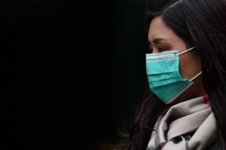 Pedestrian wearing a face mask
