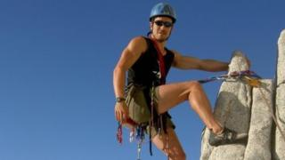 Niall McCann climbing a mountain