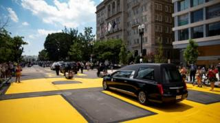 in_pictures The casket of civil rights pioneer John Lewis, who died July 17, drives on 16th Street, renamed Black Lives Matter Plaza, near the White House, in Washington