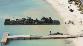 Navy vessel in Caribbean bay
