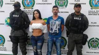 Photo released by Cali police of Paulin Karine Díaz and a man flanked by anti-kidnapping officers