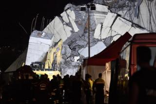 Rescuers work into the night at the site of the Morandi viaduct upon which the A10 motorway runs that collapsed in Genoa, Italy, 14 August 2018
